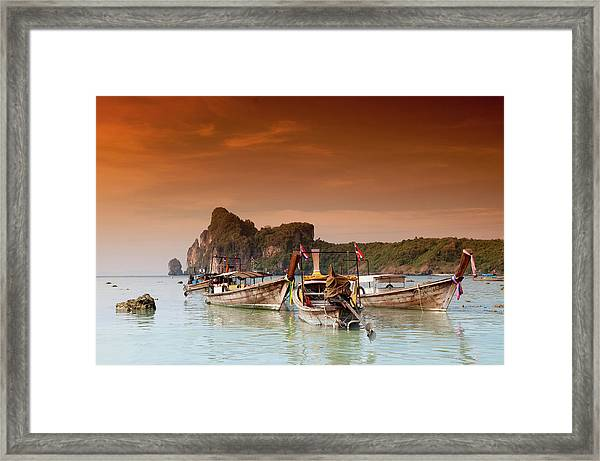 Longboats In The Afternoon Glow Framed Print