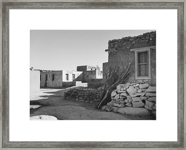 Looking Across Street Toward Houses Framed Print