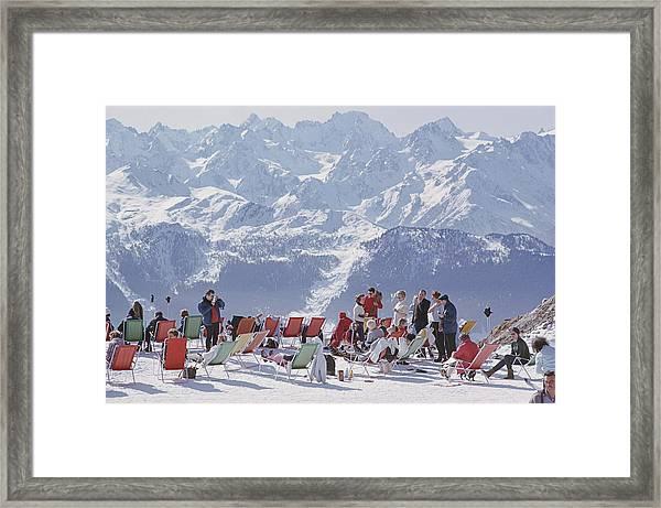 Lounging In Verbier Framed Print by Slim Aarons