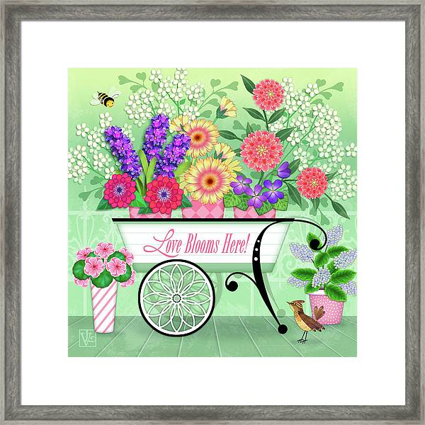 Love Blooms Here Framed Print
