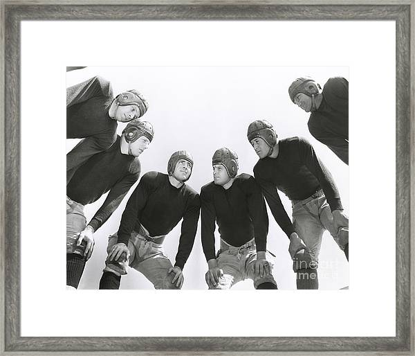 Low Angle View Of Football Huddle Framed Print