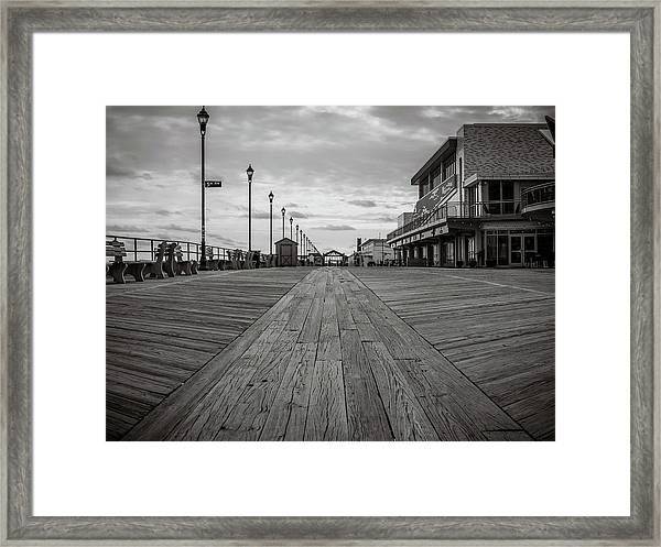 Low On The Boardwalk Framed Print