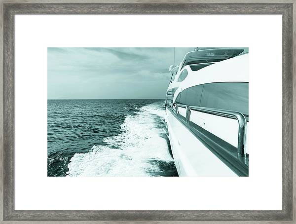 Luxury Yacht Sailing At Sea. Blue Toned Framed Print