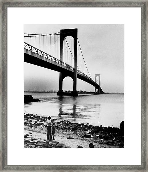 Man And Boy Looking Up At The Bronx Framed Print