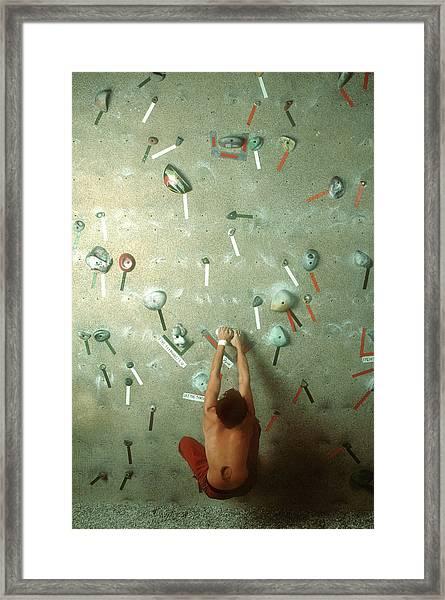 Man At Base Of Indoor Climbing Wall Framed Print