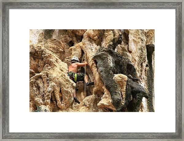 Man Climbing Rock Framed Print