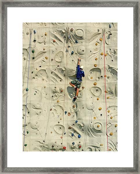 Man Climbing Wall In Gym, Rear View Framed Print