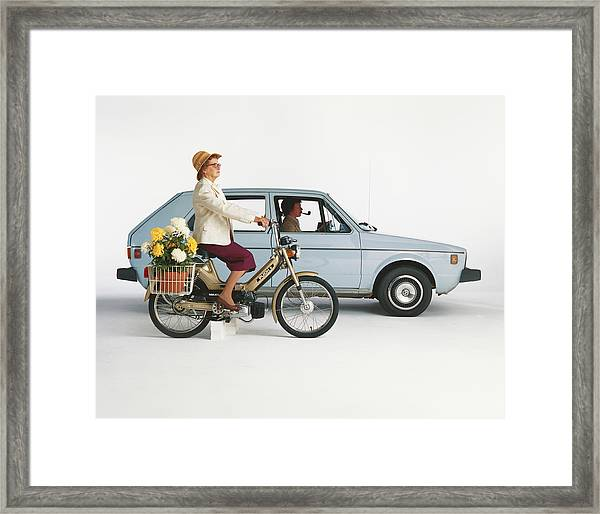 Man Driving Car And Woman Riding Framed Print