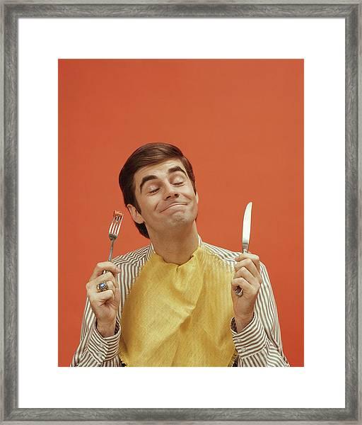 Man Holds Up A Knife And Fork, 1960s Framed Print
