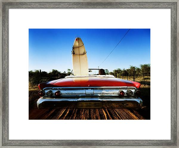 Man In Convertible Car On Dirt Road Framed Print