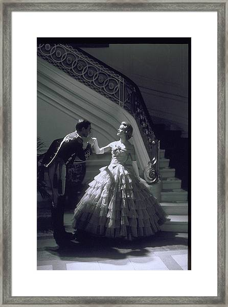 Man Kisses Hand Of Woman In Ball Gown Framed Print by Archive Holdings Inc.