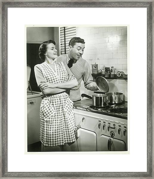 Man Looking Into Pot In Domestic Framed Print