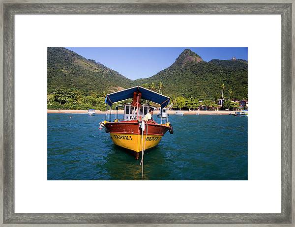 Man On Moored Boat Off Ilha Grande Framed Print