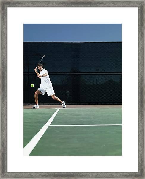 Man Playing Tennis On Court Framed Print