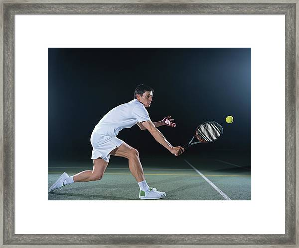Man Playing Tennis On Outdoor Court Framed Print