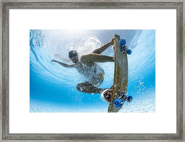Man Skateboarding Underwater In The Framed Print