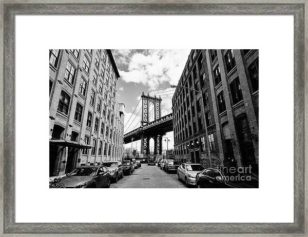 Manhattan Bridge Seen From A Brick Framed Print by Youproduction