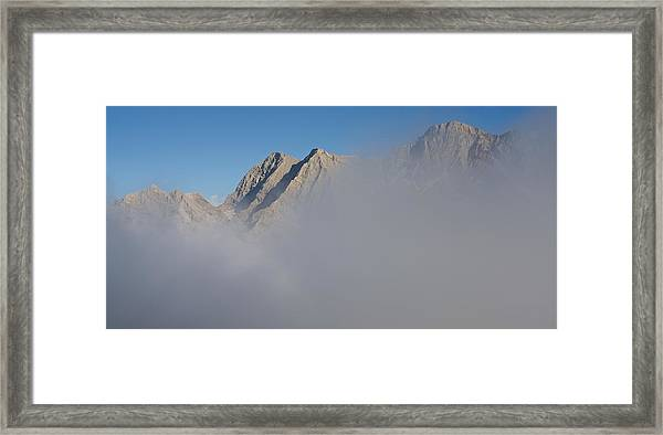 Marbore Behind The Clouds Framed Print