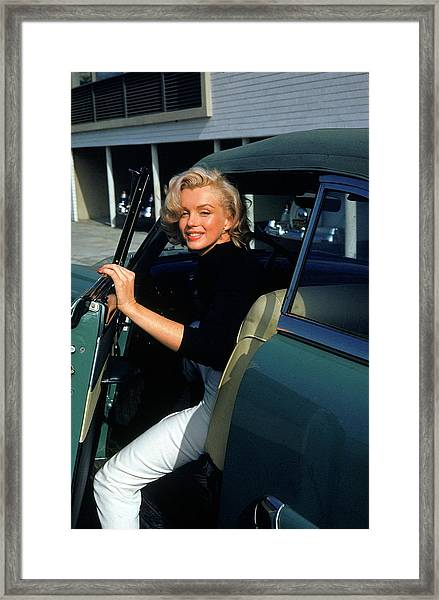 Marilyn Monroe Getting Out Of A Car Framed Print