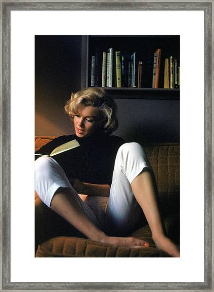 Marilyn Monroe Reading At Home Framed Print