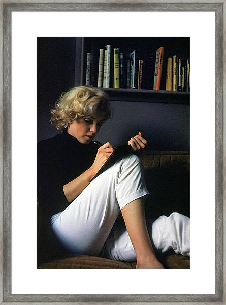 Marilyn Monroe Writing At Home Framed Print