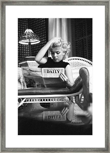 Marilyn Relaxes In A Hotel Room Framed Print by Michael Ochs Archives