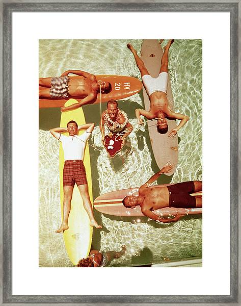Men On Surfboards In Pool Sipping Drinks Framed Print