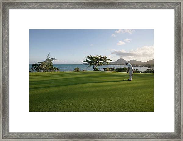 Men Playing Golf On Le Touessrok Golf Framed Print by Holger Leue
