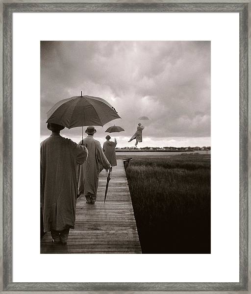 Men With Umbrellas Flying  Into Sky Framed Print