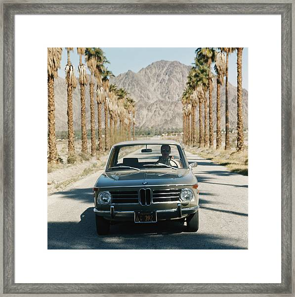 Mid Adult Man Driving Car Through Framed Print