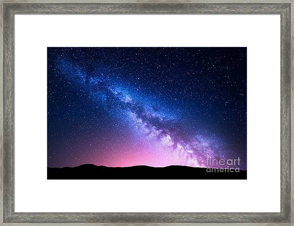Milky Way And Pink Light At Mountains Framed Print