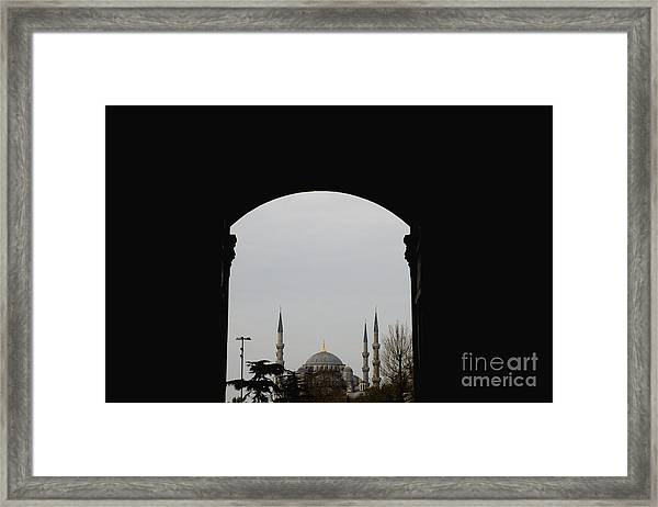 minarets in the city for the prayer of the Muslim religion Framed Print