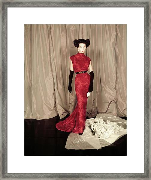 Model In A Red Balmain Gown Framed Print