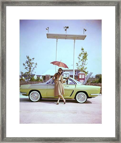 Model In Front Of A Gold Renault Caravelle Framed Print by Jerry Schatzberg