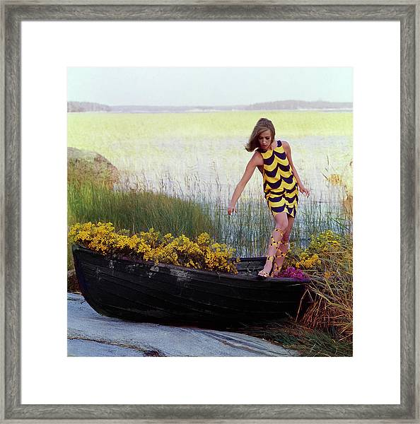 Model In Rowboat Filled With Yellow Flowers Framed Print by Gordon Parks