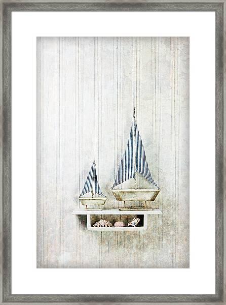 Model Sailboats With Seashells Framed Print