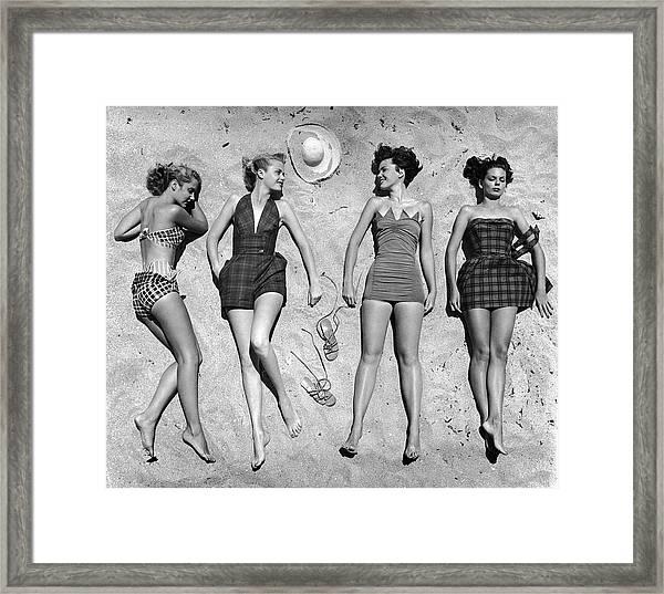 Models Lying On Beach To Display Framed Print