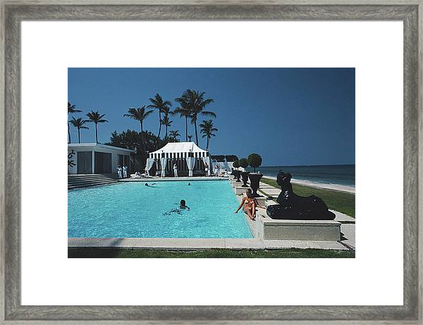 Molly Wilmots Pool Framed Print by Slim Aarons