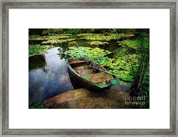 Monet's Gardeners Boat Framed Print