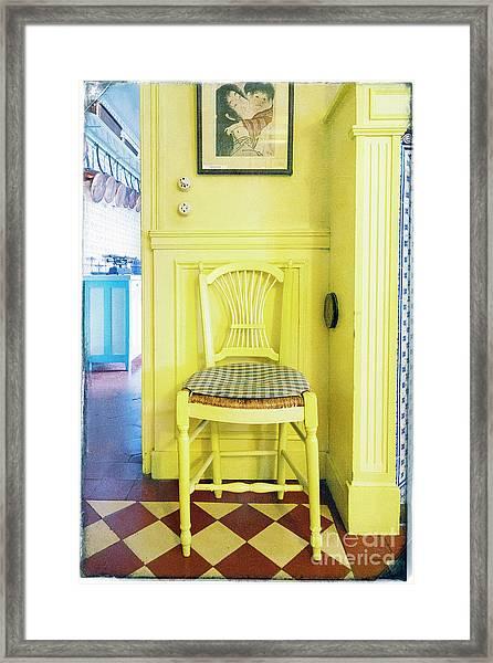 Monet's Kitchen Yellow Chair Framed Print