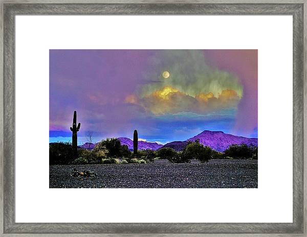 Moon At Sunset In The Desert Framed Print
