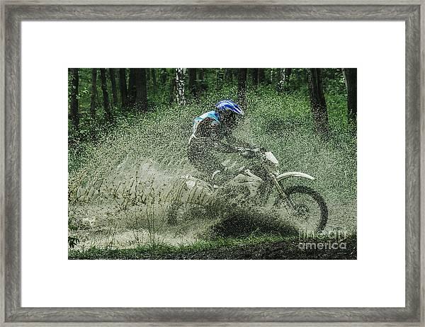 Motocross Driver Under The Spray Of Mud Framed Print