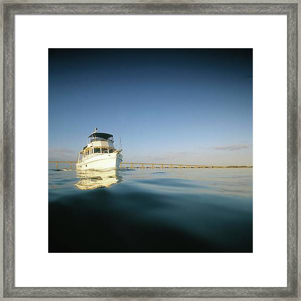 Motor Yacht With Reflection Framed Print
