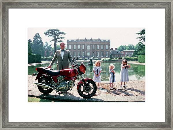 Motorcycling Lord Framed Print