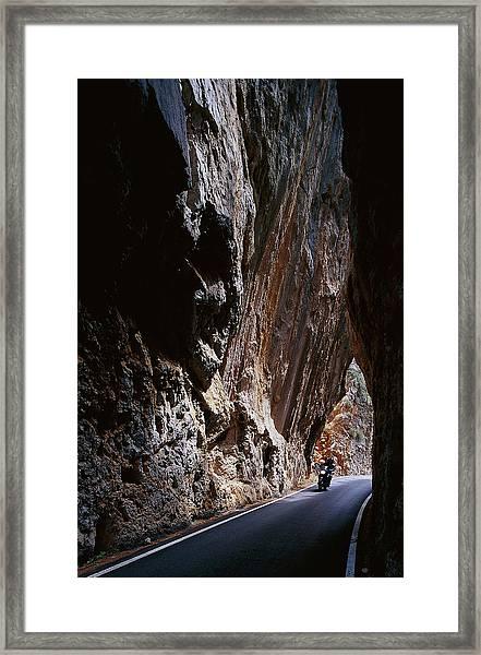 Motorcyclist Driving Through A Narrow Framed Print