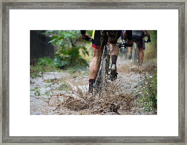 Mountain Bikers Driving In Rain Framed Print by Pavel1964