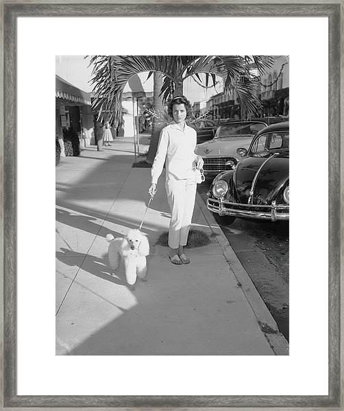 Mrs. Wrightsman Walks Her Poodle Framed Print
