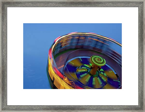 Multicolored Spinning Carnival Ride Framed Print by By Ken Ilio