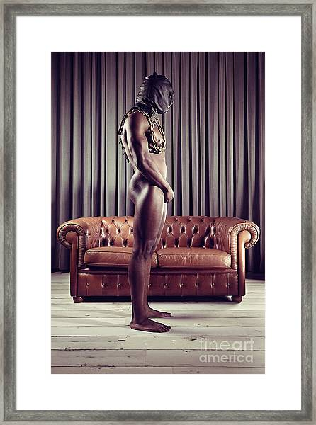 Naked Man With Mask Standing In Front Of A Sofa Framed Print