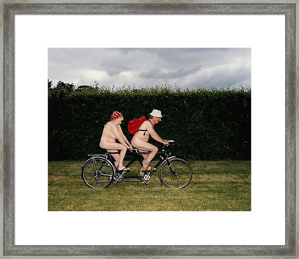 Naked Mature Couple Riding Tandem Framed Print